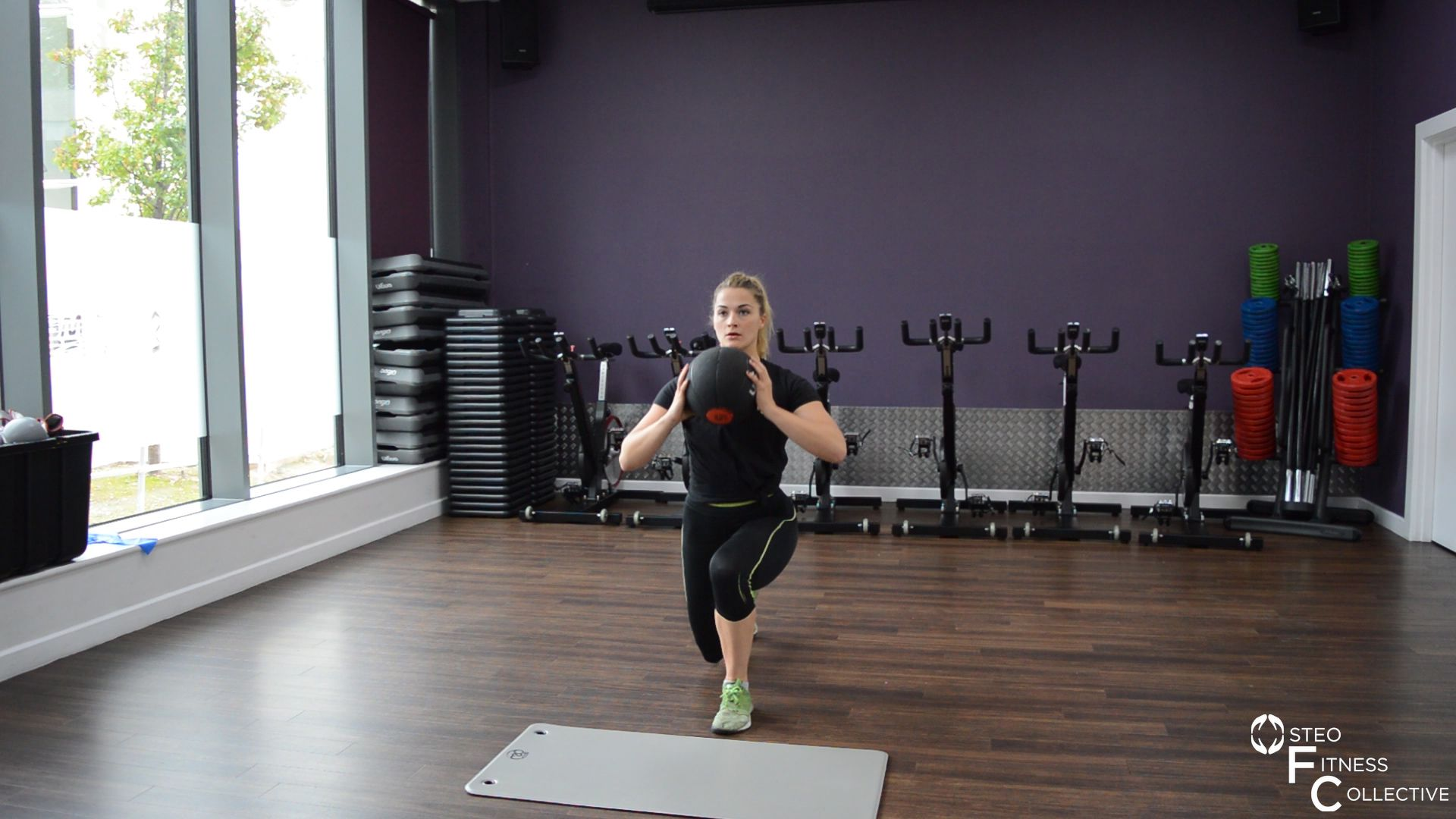 Medicine ball workout, lunge and twist