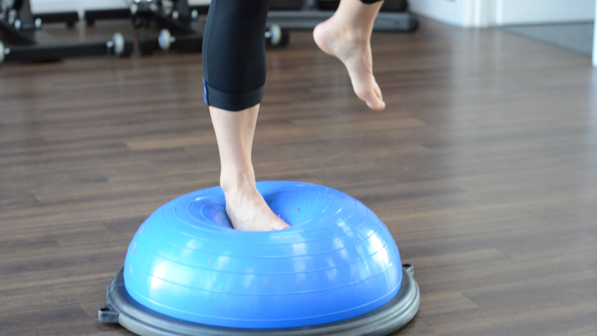 one legged ankle stability exercise on wobble board
